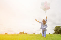 Happy asin beautiful woman with colorful balloons Royalty Free Stock Images