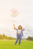 Happy asin beautiful woman with colorful balloons Stock Photography