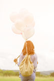 Happy asin beautiful woman with colorful balloons Royalty Free Stock Photography