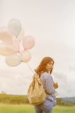 Happy asin beautiful woman with colorful balloons Royalty Free Stock Photo