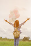Happy asin beautiful woman with colorful balloons Stock Photo