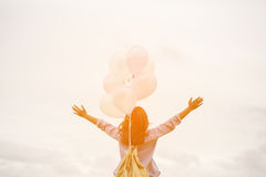 Happy asin beautiful woman with colorful balloons Royalty Free Stock Image