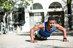 Happy athlete doing push-ups Royalty Free Stock Images