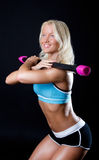 Happy athlete holding fit bar Royalty Free Stock Image