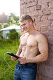 Happy athlete holding tablet, watching a movie laughing, resting Stock Image
