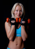 Happy athlete holding weights Royalty Free Stock Photo
