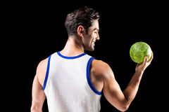 Happy athlete male holding a ball Stock Photography