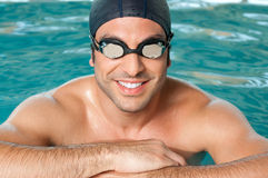 Happy athlete at pool Royalty Free Stock Images
