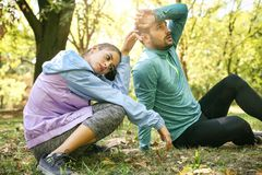 Happy athletes taking a break from exercising in nature. Nature Royalty Free Stock Photos