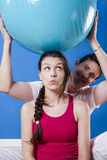 Happy athletic couple with fitness ball. Stock Photography