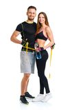 Happy athletic couple - man and woman with measuring tape on the. Happy athletic couple - men and women with measuring tape on the white background stock photos