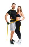 Happy athletic couple - man and woman with measuring tape on the. Happy athletic couple - men and women with measuring tape on the white background royalty free stock image