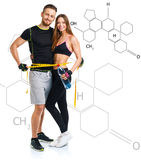 Happy athletic couple - man and woman with measuring tape with t stock photography