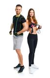 Happy athletic couple - man and woman with with ropes on the whi Royalty Free Stock Photo