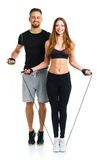 Happy athletic couple - man and woman with with ropes on the whi. Happy athletic couple - men and women with with ropes on the white background stock images