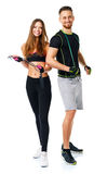 Happy athletic couple - man and woman with ropes on the white. Happy athletic couple - men and women with ropes on the white background royalty free stock image