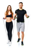 Happy athletic couple - man and woman with ropes on the white. Happy athletic couple - men and women with ropes on the white background stock image