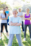 Happy athletic group with arms crossed Royalty Free Stock Photo