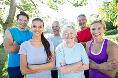 Happy athletic group with arms crossed Stock Images