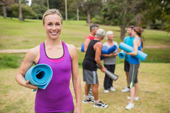 Happy athletic group holding mat Royalty Free Stock Photo