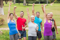 Happy athletic group holding up their fist Royalty Free Stock Images