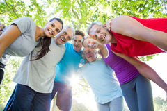 Happy athletic group looking down at the camera. On a sunny day Royalty Free Stock Photo