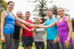 Happy athletic group putting their hands together Royalty Free Stock Photo