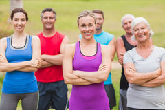 Happy athletic group smiling at camera with hands crossed stock photos