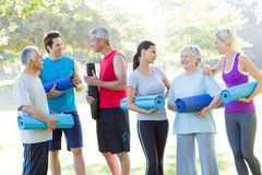 Happy athletic group talking. On a sunny day Stock Image