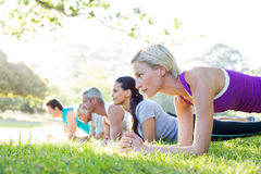 Happy athletic group training Royalty Free Stock Images