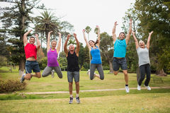 Happy athletic jumping together Royalty Free Stock Images