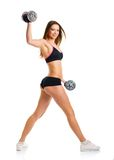 Happy athletic woman with dumbbells doing sport exercise, isolat Stock Photography