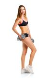 Happy athletic woman with dumbbells doing sport exercise, isolat Royalty Free Stock Image