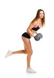 Happy athletic woman with dumbbells doing sport exercise, isolat Stock Photos