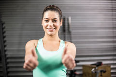 Happy athletic woman with thumbs up. At crossfit gym Royalty Free Stock Photos