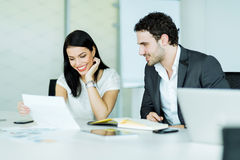 Happy atmosphere between a businesswoman and a businessman Stock Image