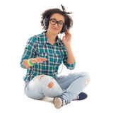 Happy attractive african american teenage girl sitting and liste Stock Images
