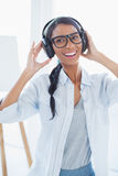 Happy attractive artist listening to music Royalty Free Stock Image