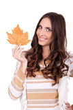 Happy attractive autumn woman holding leaf Royalty Free Stock Photography