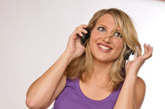 Happy Attractive Blond Woman With Headphones. Photo Of A Happy Attractive Blond Woman With Headphones Royalty Free Stock Images