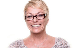 Happy attractive blond woman wearing glasses Stock Photos