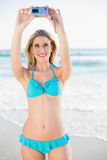 Happy attractive blonde in bikini taking a self picture Royalty Free Stock Photography
