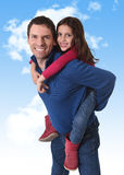Happy attractive Brazilian father carrying sweet young daughter on his back having fun Royalty Free Stock Photography