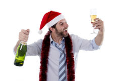 Happy attractive business man drinking champagne at office christmas party Stock Photo