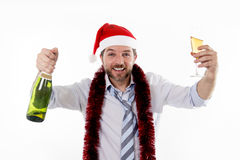Happy attractive business man drinking champagne at office christmas party Royalty Free Stock Photos