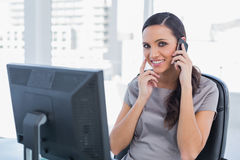 Happy attractive businesswoman having a phone conversation Royalty Free Stock Photo