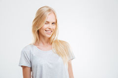Happy attractive casual girl standing and winking Stock Photo