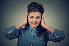 Happy attractive casual woman covering with hands her ears eyes opened Royalty Free Stock Image
