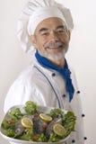 Happy attractive cook Stock Photo