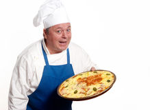 Happy attractive cook with pizza Royalty Free Stock Photography